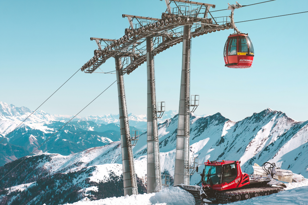 image of ski lifts and piste basher