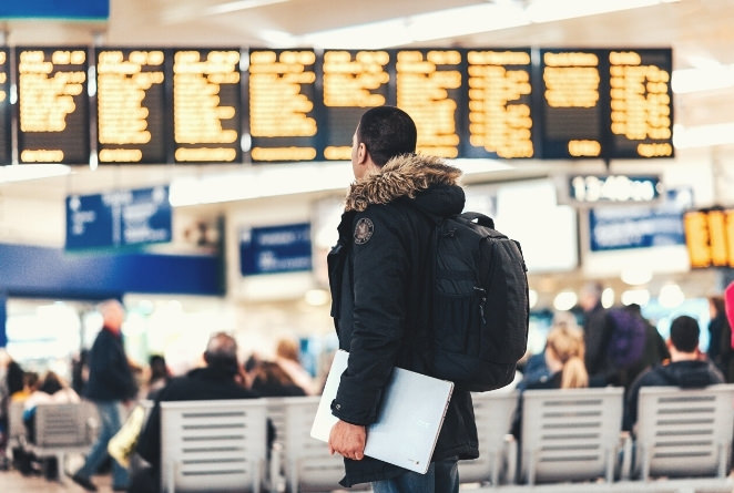 man in airport on his way to a ski holiday